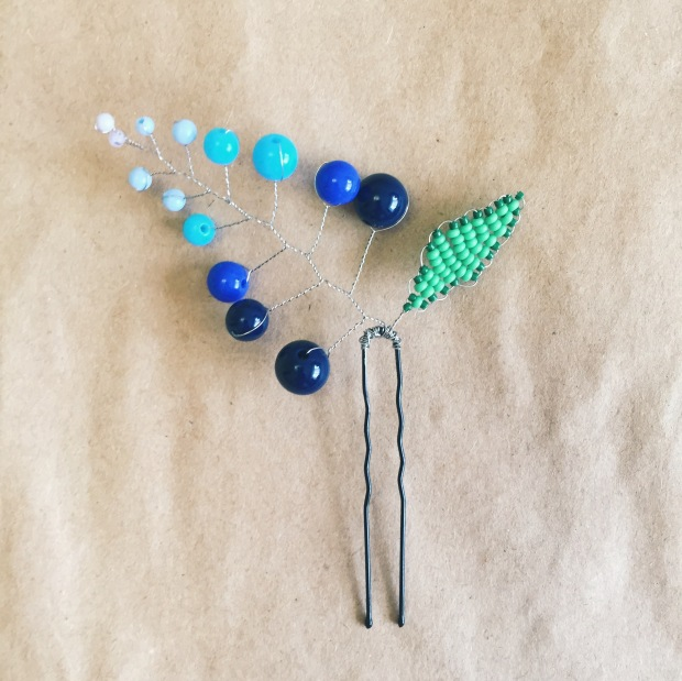 Omrbe blue beads from lightest to darkest with silver wire and easy green leaf from beads