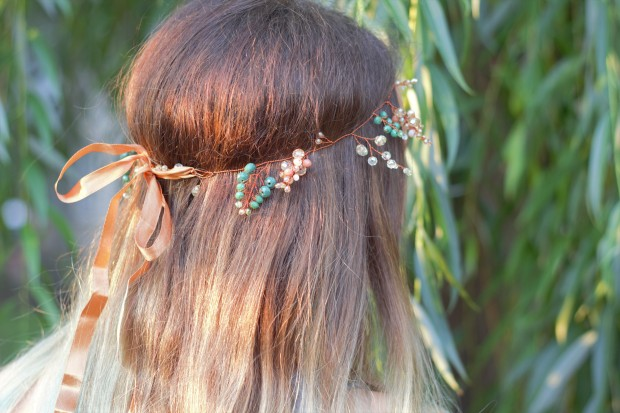 Handmade hair vine from green and golden crystals with ribbon in the hair