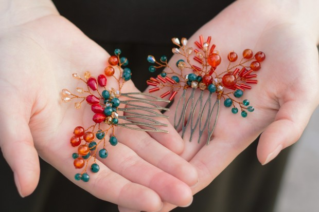 2 mini fall inspired hair combs in hands