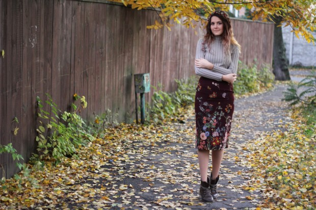 A beautiful fall inspired picture with a girl in a skirt with flowers
