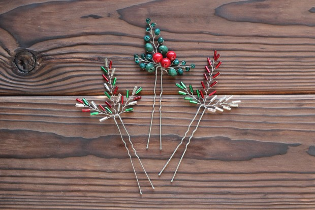 3 cute festive red, green, and silver hair pins from beads on the dark wood background