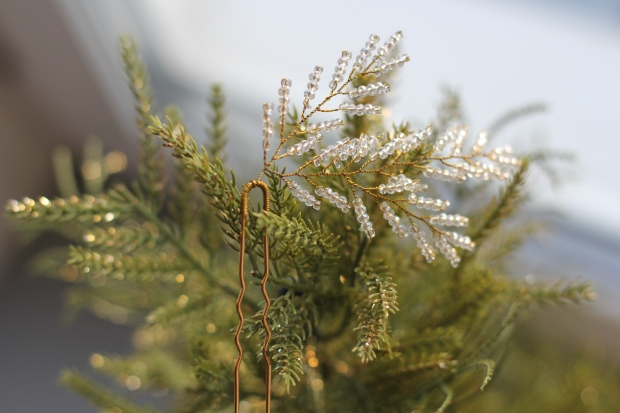 Beautiful shiny golden hair accessory in form of Christmas tree branch