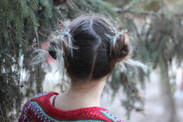 Two messy hair buns with cute Christmas inspired hair pins
