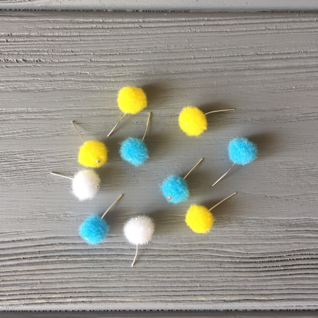Blue, yellow, white little pompoms