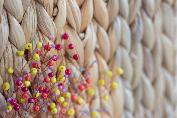 colorful beads on blurred beige background